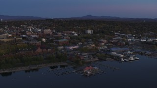DX0002_225_041 - 5.7K stock footage aerial video of an orbit of downtown and the lakeside marinas at twilight, Burlington, Vermont