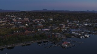 DX0002_225_042 - 5.7K stock footage aerial video approach and orbit downtown and the lakeside marinas at twilight, Burlington, Vermont