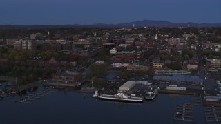 DX0002_225_044 - 5.7K stock footage aerial video circling around downtown area and the lakeside marinas at twilight, Burlington, Vermont