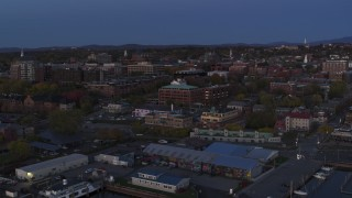 DX0002_225_045 - 5.7K stock footage aerial video circling around the downtown area at twilight, Burlington, Vermont
