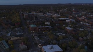 DX0002_225_046 - 5.7K stock footage aerial video circling and flying away from the downtown area at twilight, Burlington, Vermont