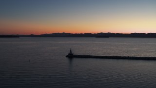 DX0002_226_004 - 5.7K stock footage aerial video stationary view of Lake Champlain lighthouse at twilight, Burlington, Vermont