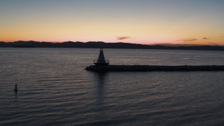 DX0002_226_005 - 5.7K stock footage aerial video of orbiting a Lake Champlain lighthouse at twilight, Burlington, Vermont