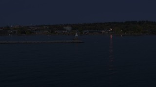 DX0002_226_007 - 5.7K stock footage aerial video of orbiting around a Lake Champlain lighthouse at night, Burlington, Vermont