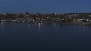 DX0002_226_009 - 5.7K stock footage aerial video slowly approaching the downtown area at twilight, seen from the lake, Burlington, Vermont