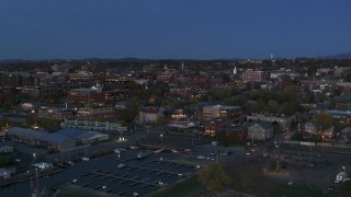 DX0002_226_010 - 5.7K stock footage aerial video slowly approaching downtown area office buildings at twilight, Burlington, Vermont