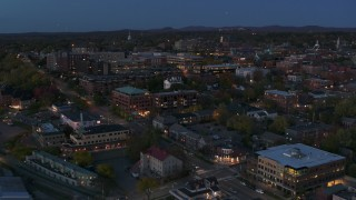 DX0002_226_011 - 5.7K stock footage aerial video slowly orbit and fly away from downtown area office buildings at twilight, Burlington, Vermont