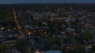 DX0002_226_013 - 5.7K stock footage aerial video circle and fly away from downtown area office buildings at twilight, Burlington, Vermont