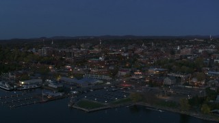 DX0002_226_014 - 5.7K stock footage aerial video reverse view of city's downtown area at twilight, reveal marina, Burlington, Vermont