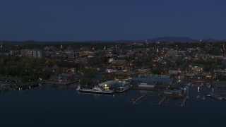 DX0002_226_015 - 5.7K stock footage aerial video a wide orbit of city's downtown area and marinas at twilight, Burlington, Vermont