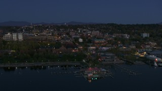 DX0002_226_016 - 5.7K stock footage aerial video of city's downtown area and a marina at twilight, Burlington, Vermont