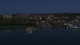 DX0002_226_017 - 5.7K stock footage aerial video of a slow orbit of city's downtown area and marinas at night, Burlington, Vermont