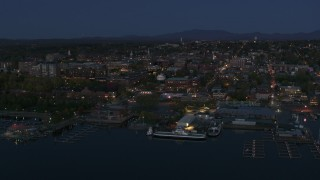 DX0002_226_018 - 5.7K stock footage aerial video ascend and orbit city's downtown area and marinas at night, Burlington, Vermont