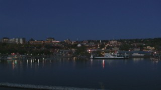 DX0002_226_022 - 5.7K stock footage aerial video fly low toward the city's downtown area and over a marina at night, Burlington, Vermont
