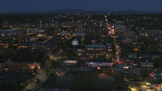 DX0002_226_023 - 5.7K stock footage aerial video orbit the city's downtown area lit up for the night, Burlington, Vermont