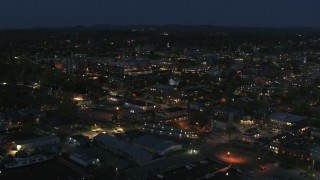 DX0002_226_030 - 5.7K stock footage aerial video focus on the city's downtown area lit up for the night while circling city, Burlington, Vermont