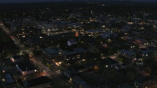 DX0002_226_031 - 5.7K stock footage aerial video of the downtown area lit up for nighttime, Burlington, Vermont