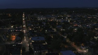 DX0002_226_032 - 5.7K stock footage aerial video fly away from and orbit the downtown area lit up for nighttime, Burlington, Vermont