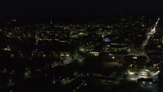 DX0002_226_034 - 5.7K stock footage aerial video circling the downtown area and College Street lit up for nighttime, Burlington, Vermont