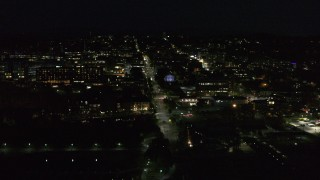DX0002_226_035 - 5.7K stock footage aerial video orbit the downtown area around College Street lit up for nighttime, Burlington, Vermont