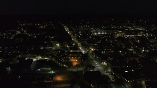 DX0002_226_039 - 5.7K stock footage aerial video of an orbit of office buildings on Battery Street lit up for nighttime, Burlington, Vermont