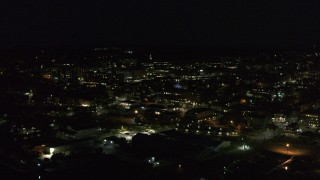 DX0002_226_040 - 5.7K stock footage aerial video of slowly orbiting office buildings in downtown lit up for nighttime, Burlington, Vermont