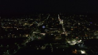 DX0002_226_041 - 5.7K stock footage aerial video of slowly orbiting office buildings and streets in downtown lit up for nighttime, Burlington, Vermont