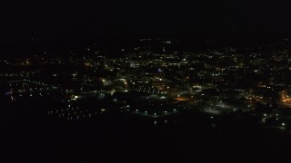 DX0002_226_045 - 5.7K stock footage aerial video of approaching downtown from the lake at nighttime, Burlington, Vermont