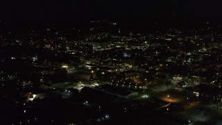 DX0002_226_046 - 5.7K stock footage aerial video of approaching downtown office buildings from the lake at nighttime, Burlington, Vermont