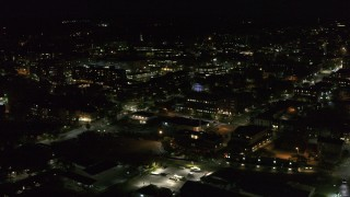 DX0002_226_047 - 5.7K stock footage aerial video of flying around downtown office buildings at nighttime, Burlington, Vermont