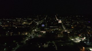 DX0002_226_048 - 5.7K stock footage aerial video of downtown buildings and streets at nighttime, Burlington, Vermont
