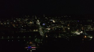 DX0002_226_049 - 5.7K stock footage aerial video of a view of city buildings in downtown at night, Burlington, Vermont