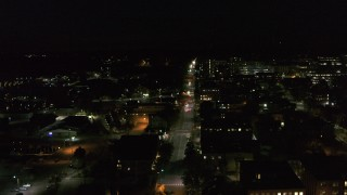 DX0002_226_051 - 5.7K stock footage aerial video of Battery Street and office buildings in downtown at night, Burlington, Vermont
