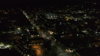 DX0002_226_057 - 5.7K stock footage aerial video fly around office buildings by Battery Street at night, Burlington, Vermont