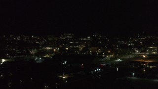 DX0002_226_060 - 5.7K stock footage aerial video orbit the downtown area at night, seen from marinas, stop for stationary view, Burlington, Vermont