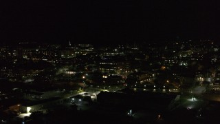 DX0002_226_061 - 5.7K stock footage aerial video ascend and orbit the downtown area at night, Burlington, Vermont