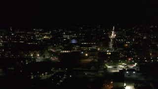 DX0002_226_062 - 5.7K stock footage aerial video orbit the downtown area near Main Street at night, Burlington, Vermont