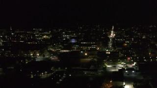 DX0002_226_062 - 5.7K stock footage aerial video orbit the downtown area near Main Street at night, Burlington, Vermont