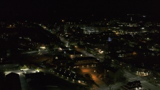 DX0002_226_064 - 5.7K stock footage aerial video fly away from the downtown area near Battery Street at night and descend, Burlington, Vermont