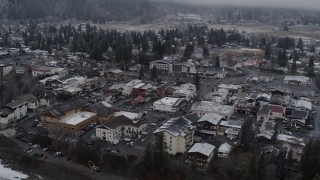 DX0002_227_006 - 5.7K stock footage aerial video of orbiting rooftops with light snow in the small town of Leavenworth, Washington