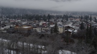DX0002_227_008 - 5.7K stock footage aerial video ascend from trees to reveal the small town, Leavenworth, Washington