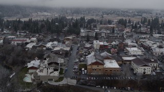 DX0002_227_009 - 5.7K stock footage aerial video rooftops dusted with snow in the small town, Leavenworth, Washington