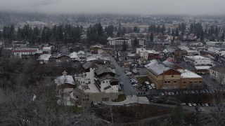 DX0002_227_010 - 5.7K stock footage aerial video orbit rooftops dusted with snow in the small town, Leavenworth, Washington