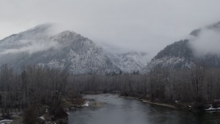 DX0002_227_015 - 5.7K stock footage aerial video ascend from river to reveal Leavenworth, Washington