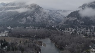 DX0002_227_016 - 5.7K stock footage aerial video follow the river toward Leavenworth, Washington and snowy mountains