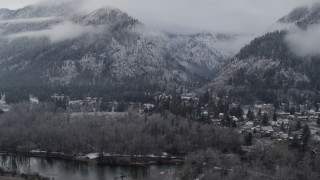 DX0002_227_017 - 5.7K stock footage aerial video approach Leavenworth and snowy mountains, Washington