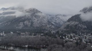DX0002_227_018 - 5.7K stock footage aerial video a reverse view of Leavenworth and snowy mountains, Washington