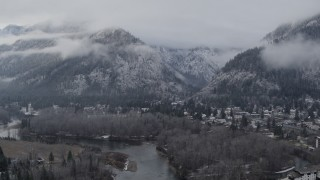DX0002_227_019 - 5.7K stock footage aerial video of flying away from Leavenworth and snowy mountains, Washington