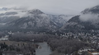 DX0002_227_020 - 5.7K stock footage aerial video of flying by Leavenworth and snowy mountains, Washington