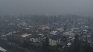 DX0002_227_022 - 5.7K stock footage aerial video of orbiting Christmas trees as it snows, Leavenworth, Washington